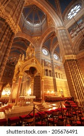 Gothic cathedral interior and altar at night