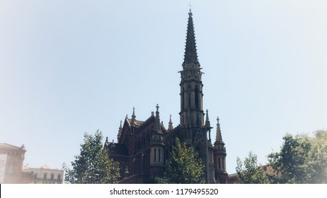 Gothic cathedral, Gothic cathedral with a spire and a tower surrounded by trees, vignetting