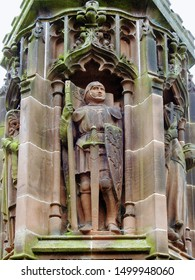 Gothic column statue of Saint Maurice warrior who represents the infantry. At Chester Cathedral in the city of Chester, Cheshire, England