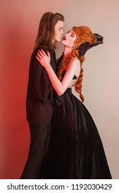 Gothic couple in halloween clothes. Woman temptation. Vampire in renaissance dress. Gothic costume for halloween. Sweetheart couple on dark. Girl in renaissance clothing. Sweetheart feel temptation