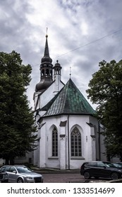 Gothic exterior with Baroque bell tower of lutheran St. Mary's Cathedral, also known as Dome Church, against grey cloudy sky in Tallinn, Estonia. Oldest church in Tallinn and mainland Estonia.