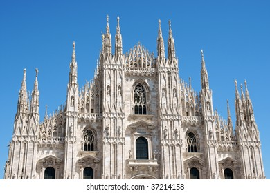 Gothic facade of Milan Cathedral in Piazza del Duomo. It is the fourth largest church in the world. The construction started in 1386 and took about five centuries.