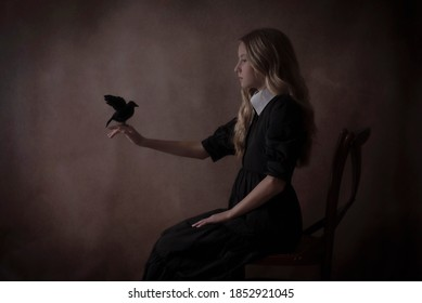Gothic girl holding a crow.
