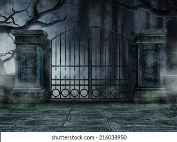 Gothic graveyard gate with old withered trees