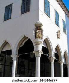 Gothic loggia in the old town of Koper, Slovenia. The restaurant in the building of the Loggia Palace on the main square of the city. Columns and arch in Venetian Gothic style.