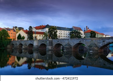 Gothic medieval stony bridge on Otava river. The oldest bridge in historical town Pisek, South Bohemia, Czech republic, Europe. - Shutterstock ID 472411972