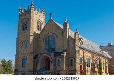 gothic revival style architecture of church entrance and bell tower in saint paul minnesota