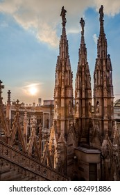 gothic spires over blue sky on roof of Milan cathedral (Duomo), Italy