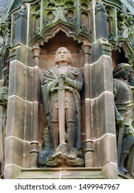 Gothic style column statue of Saint George, the patron of England. At Chester Cathedral in the city of Chester, Cheshire, England