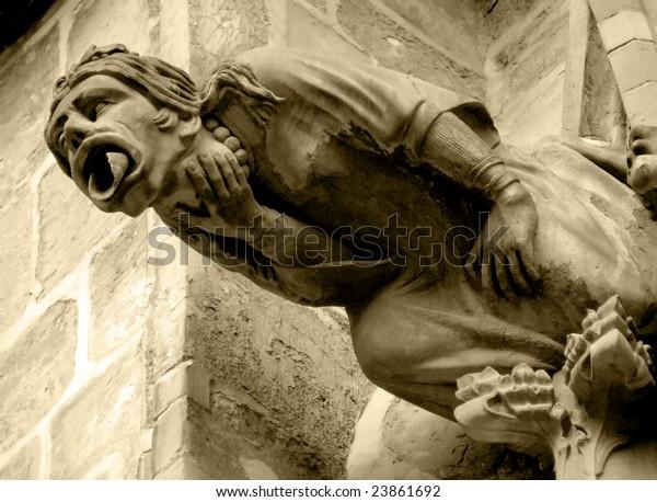 Gothic style Gargoyle on St Vitus' Cathedral Prague. Sepia