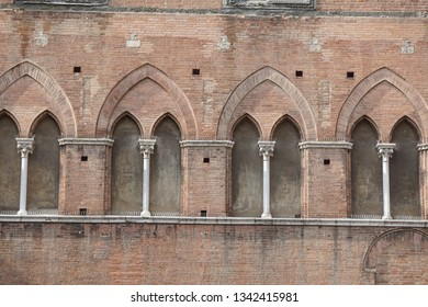 gothic style windows in Siena, Italy .detail