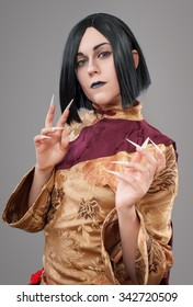 Gothic woman with chinese nails. Dark gothic woman with cloak and chinese nails