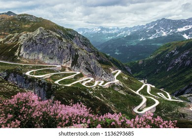 Gotthard pass with the historic curvy road on a summer cloudy day in Switzerland
