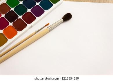 gouache, tassels, watercolor paint, white sheet of paper.