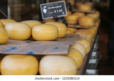 """Gouda cheese in shop window in Amsterdam - Text on the tag: """"Gouda natural - 7.50 Euro"""""""