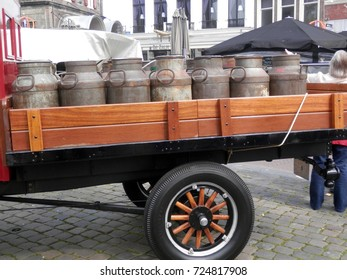Gouda, Holland - April 24, 2014: Old fashioned lorry with milk churns at Gouda Cheese Market