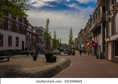 Gouda, Holland, Netherlands, April 23, 2019A little square in Gouda old town, bicycles parked near a bridge in a street of town. Flowers on the background