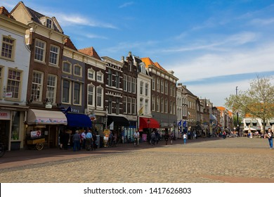 Gouda, Holland, Netherlands, April 23, 2019. The market square in Gouda old town, a street of dutch style facades of houses with shops and cafes.