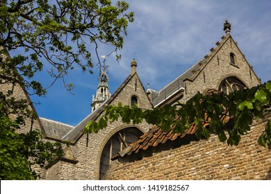 Gouda, Holland, Netherlands, April 23, 2019. View of the Sint-Janskerk church roof and bell tower near the market square (highest in the Netherlands), the view from museum Gouda