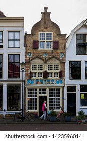 Gouda, Holland, Netherlands, April 23, 2019. The Gouda old town, a street of dutch style facades of houses. The oldest facade in Gouda