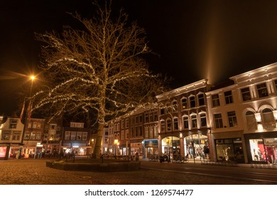 The Gouda market in the evening with a lighted tree and houses with old facades. The Netherlands, Europe.