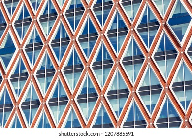 GOUDA, THE NETHERLANDS - 12 OCTOBER, 2018: Modern Dutch Architecture: Detail of the Town hall of the municipality of Gouda designed by Jos van Eldonk. Inspired by the Stroopwafels or Syrup waffles.