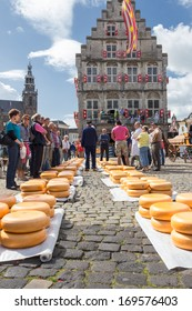 GOUDA, NETHERLANDS -12th of April 2012: Unknown people seen during Friday Traditional cheese market in which took place on 12th of April 2012 in GOUDA, NETHERLANDS