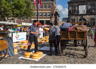 GOUDA, NETHERLANDS -12th of April 2012: Dutch Traditional cheese market on 12th of April 2012 in GOUDA, NETHERLANDS