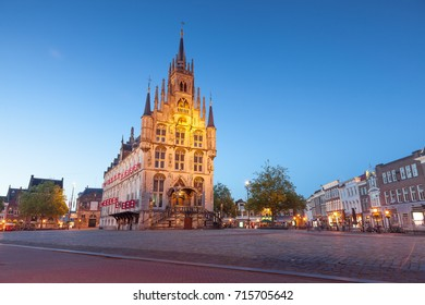 Gouda, Netherlands - July 5 2017: Dusk landscape traditional town hall in famous from cheese industry Gouda city