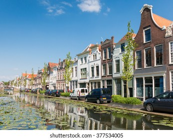 GOUDA, NETHERLANDS - JUN 10, 2015: Facades of old houses on Turfmarkt canal in Gouda