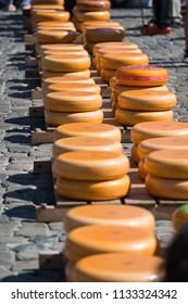 Gouda, Netherlands, Jun 26 2018: Stacked cheese at the Gouda cheese market, Netherlands