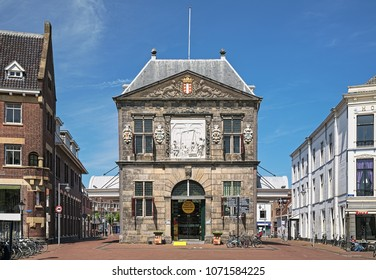 GOUDA, NETHERLANDS - MAY 24, 2015: Waag (or Kaaswaag) - a cheese weighing house at the Markt square. The Waag was built in 1668-1670 by design of Pieter Post. It currently hosts a small cheese museum.