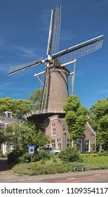 GOUDA, NETHERLANDS - MAY 24, 2015: Molen 't Slot (Mill on the Castle). The present windmill was built in 1832 on the site where the Gouda castle once stood.