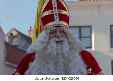 Gouda, The Netherlands - November 17 2018: Sinterklaas/ Saint Nicholas is smiling with his friendly face on the market of Gouda.