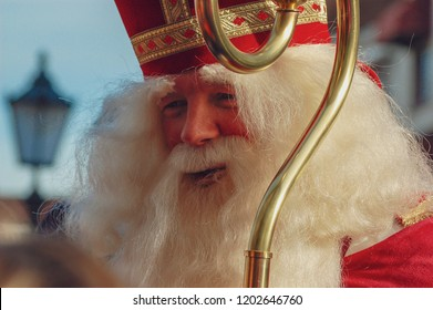 Gouda, The Netherlands - November 18, 2006: close up of smiling Saint Nicholas during the annual typical Dutch parade.