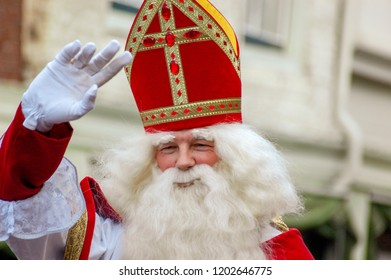 Gouda, The Netherlands - November 18, 2006: Saint Nicholas waves to the audience during a typical Dutch festival.
