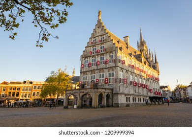 Gouda, The Netherlands - October 10th 2018. The old city hall of Gouda. The Gothic style building dates from 1459.