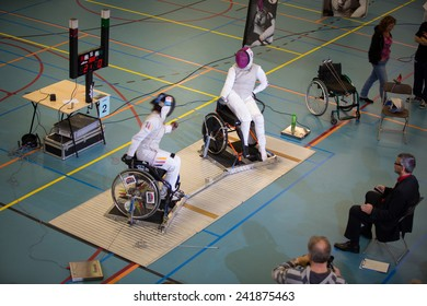 Gouda, NETHERLANDS -? OCTOBER 11 : Physically disabled athletes fencing in a wheelchair during an international tournament on OCTOBER 11, 2014 in GOUDA, NETHERLANDS