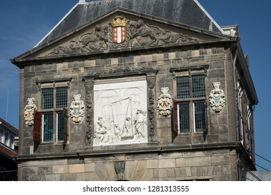 Gouda, The Netherlands - October 15th 2018: Facade of the Old Weigh House (De Waag), a museum at Market Square in Gouda, Holland.