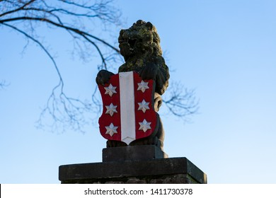 Gouda, South Holland/the Netherlands - January 20 2019: portrait shot of the lion statue with Gouda city logo on the shield