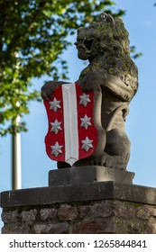 Gouda, South-Holland/The Netherlands - October 27 2018: Lion statue holding Gouda city emblem located at the Veerstal side view