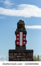 Gouda, South-Holland/The Netherlands - October 27 2018: Lion statue holding Gouda city emblem located at the Veerstal portrait mode