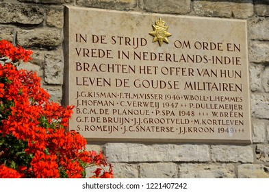 gouda, zuid holland / netherlands - july 22, 2014: commemorative plaque at gouda town hall for those gouda colonial soldiers killed in action during independence struggle (police action ) in indonesia