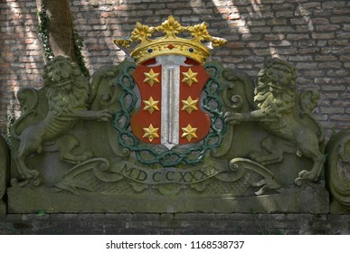 gouda, zuid holland/netherlands - july 22, 2014: sculpture of the gouda coat of arms / crest