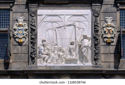 gouda, zuid holland/netherlands - july 22, 2014:  relief at historical weigh house depicting cheese weighing and trade