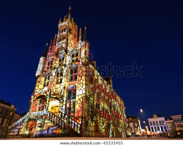 """GOUDA-JANUARY 3: 3 weeks around christmas time Gouda's city hall is being lightened.  It's the 7th time this event  """" Gouda by artificial lights""""  takes place, January 3 2010 in Gouda, Netherlands"""