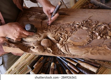 gouge wood chisel carpenter tool working wooden background, wood handcraft Thailand style,  a carpenter hands working with a chisel and carving tools on wooden workbench