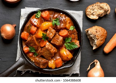 Goulash, beef stew in cast iron pan, top view, close up