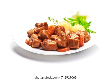 Goulash, beef stew with potatoes, isolated on white background