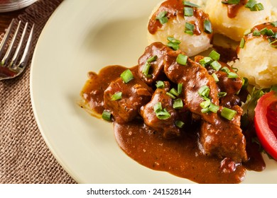 Goulash with boiled potatoes and vegetables